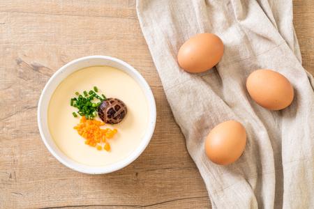 Foto de homemade steamed egg with vegetable, mushroom and carrot - Imagen libre de derechos