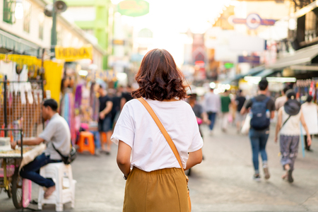 Photo for Happy and Beautiful Asian woman traveling at Khao Sarn Road in Thailand - Royalty Free Image
