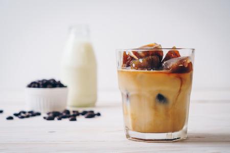 Photo pour coffee ice cubes with milk on wood table - image libre de droit