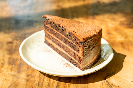 Photo pour Dark Chocolate Cheesecake on plate in cafe restaurant - image libre de droit