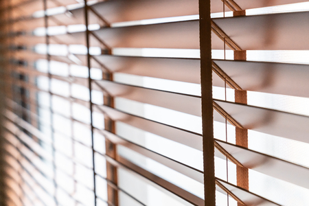 Photo pour Wooden shutters blind on the window in the living room - image libre de droit