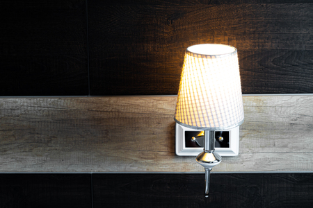 Photo for shining lamp in bedroom near bed - Royalty Free Image