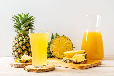 Photo for fresh pineapple juice on wood background - Royalty Free Image