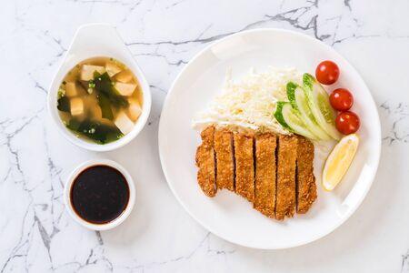 Foto de Japanese deep fried pork cutlet (tonkatsu set) - Japanese food style - Imagen libre de derechos