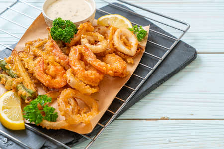 Photo for deep fried seafood (shrimps and squid) with mix vegetable - unhealthy food style - Royalty Free Image