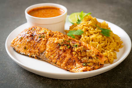 Photo for pan seared salmon tandoori with masala rice - muslim food style - Royalty Free Image