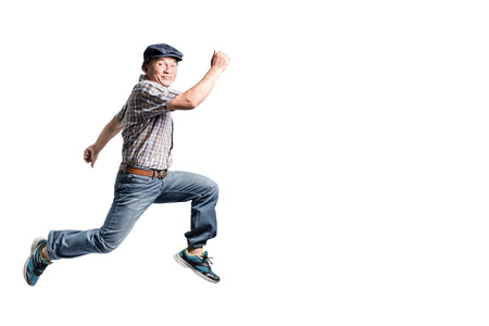 Photo for Portrait of a happy mature man jumping forward. Isolated full body on white background - Royalty Free Image