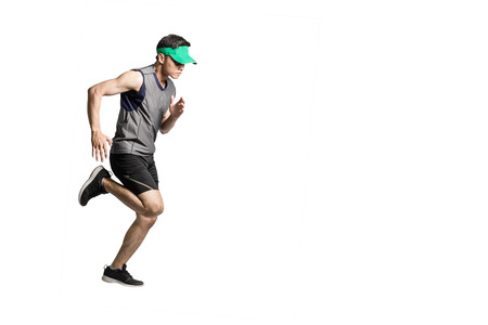 Photo pour Portrait of an asian sport man wearing sportwear and green visor for running. Isolated full length on white background with copy space - image libre de droit