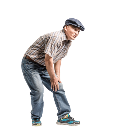 Photo pour Portrait of a mature man with knee pain. Isolated full body on white background with copy space - image libre de droit