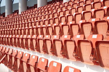 Orange color of Stadium seats on background.