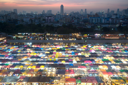 Bangkok, Thailand-December 14 , 2017 : Sunset scenic of Bangkok Panorama top view from building of Bangkok train market on December 14,2017 , This market is a beautiful colorful and wonderful of tent retail shop.