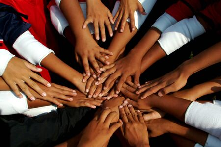 Photo pour The unity of students and colleagues who complete activities and showing joy. - image libre de droit