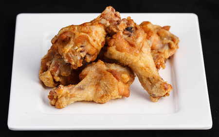 The most amazing Salt and Pepper Chicken Wings deep fried on studio photography