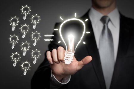 Photo pour internet, technology, network, business concept - businessman in suit presses virtual touchscreen interface button - glowing light bulb - image libre de droit