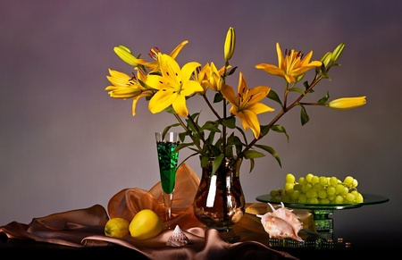 Still life with yellow lily and fresh fruits