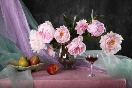 Still life with beautiful pink peonies and fruit
