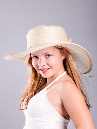 Summer portrait, beautiful blond girl  wearing straw hat