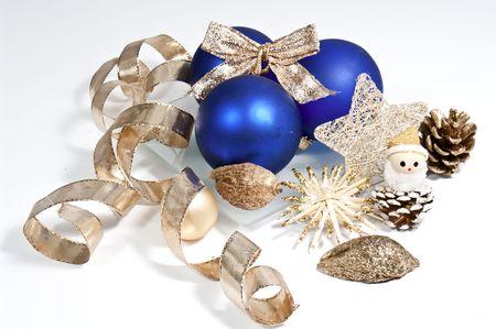 Blue christmas tree balls and golden ribbon