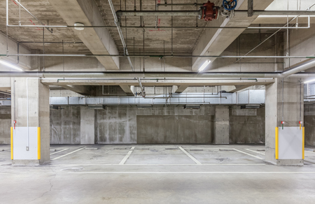 Parking garage underground interior with neon lights , Empty Parking lot , Car park at underground building