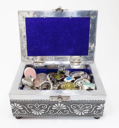 metal jewelry box full of jewelry
