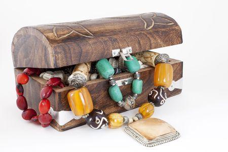 wooden jewelry box full of jewelry