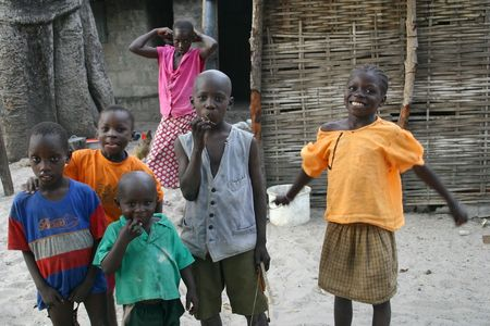 Carabane,Casamance,Senegal - February 18,2007 : Children Diola happy with the visit of the tourists, are scarce resources and tourism is an important source of revenue.