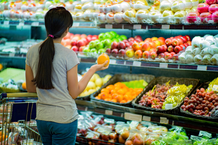 Photo for Woman are choosing fruit in supermarkets - Royalty Free Image