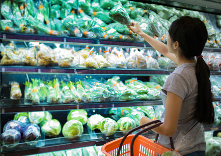 Woman are choosing vegetable in supermarketの写真素材