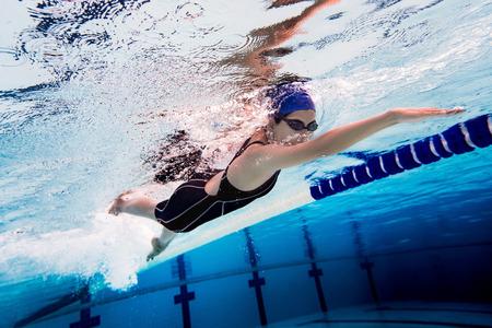 Woman swimming pool.Underwater photo