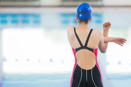 Photo for The swimmers are warm up before the pool. - Royalty Free Image