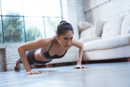 Foto de Asian women doing push up - Imagen libre de derechos