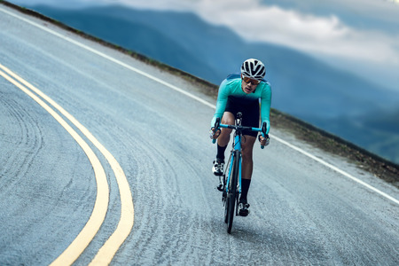Photo pour Cyclists are cycling, climbing up to the top. - image libre de droit