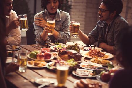 Photo pour Asian people enjoying their dinner - image libre de droit