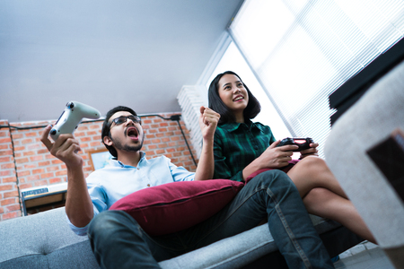 Foto de Lovers are playing at home. They know fun, excited. - Imagen libre de derechos