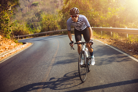 Photo pour Asian man  cycling road bike in the morning.He is on a forest road. - image libre de droit