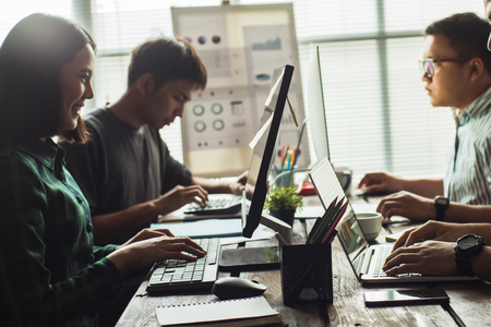 Photo pour Asian people Working together in the office. - image libre de droit