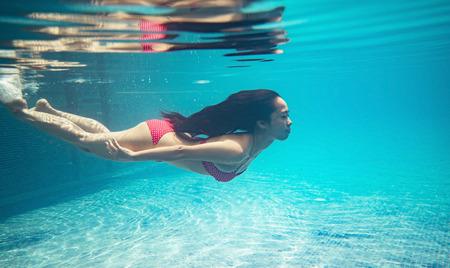 Photo pour Asian woman  diving at the pool. She was wearing a bikini - image libre de droit