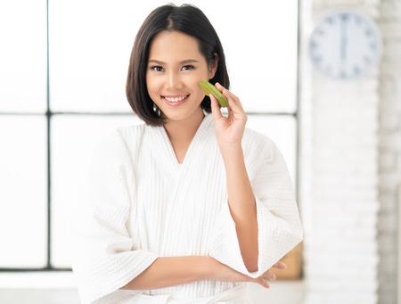 Photo pour Asian woman  using Aloe Vera on her face in the bathroom. - image libre de droit