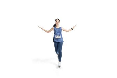 Foto de Asian women marathon Studio white background. She was pretending to be glad - Imagen libre de derechos