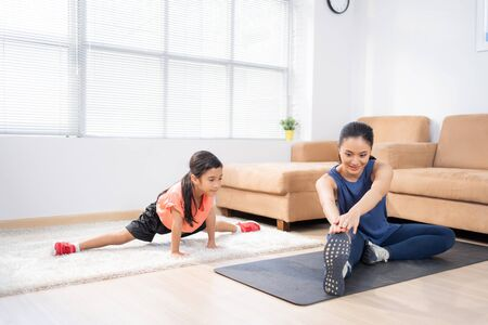 Foto de Mother and daughter exercise at home - Imagen libre de derechos