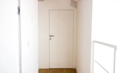 Photo pour Minimal and modern home interior, with white concrete and mild brown wood - image libre de droit