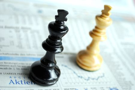 macro of chessmen standing on latest stock exchanges