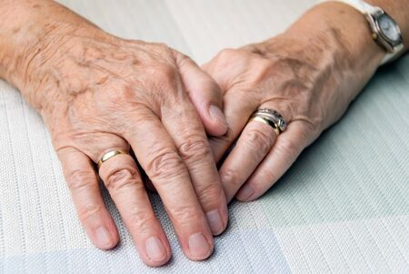 hands of an elderly woman in smooth light