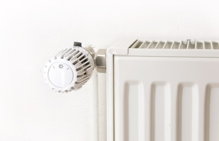white radiator in front of a wall