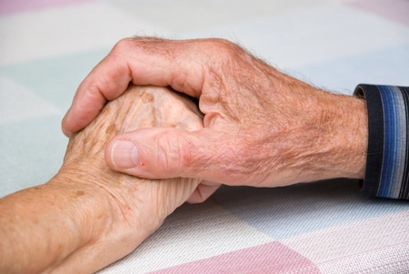 seniors holding hands in happy athmosphere