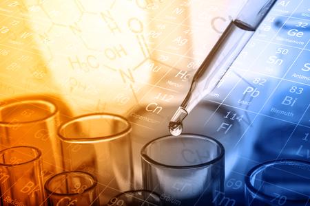 Photo pour dropping liquid to test tube, Chemical, scientific research and development concept - image libre de droit
