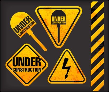 Under construction. Grunge signs with the lighting and spade