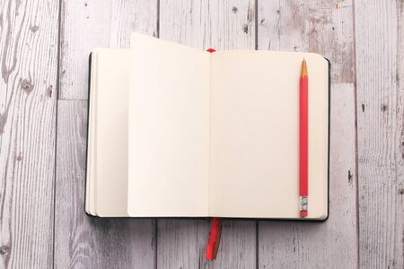 Photo for high angle view of notepad with pen on tiles background - Royalty Free Image
