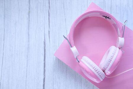 Photo pour Top view of headphone on a book on table . - image libre de droit