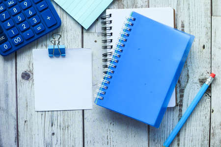 Photo for high angle view of notepad and stationary on wooden table - Royalty Free Image